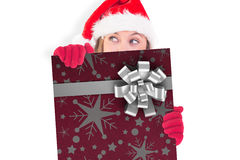 Composite image of festive blonde holding a poster Royalty Free Stock Photography