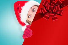 Composite image of festive blonde holding a poster Stock Photo