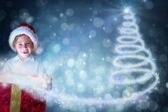 Composite image of festive boy opening gift Stock Image