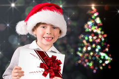 Composite image of festive boy showing letter Royalty Free Stock Image
