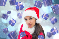 Composite image of festive brunette blowing Royalty Free Stock Images