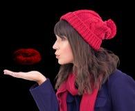 Composite image of festive brunette blowing a kiss Stock Photos
