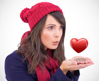 Composite image of festive brunette blowing over hands Stock Image