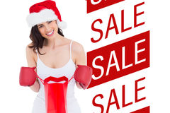 Composite image of festive brunette in boxing gloves opening shopping bag Stock Photos