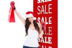 Composite image of festive brunette in boxing gloves with shopping bag Royalty Free Stock Image