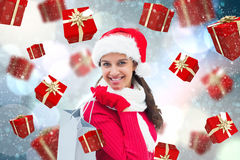 Composite image of festive brunette holding shopping bag Royalty Free Stock Images
