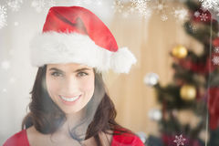 Composite image of festive brunette posing at christmas Stock Images