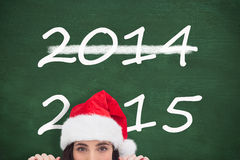 Composite image of festive brunette showing white poster Stock Photos