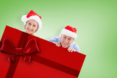 Composite image of festive couple showing poster Royalty Free Stock Image
