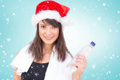 Composite image of festive fit brunette smiling at camera Stock Images