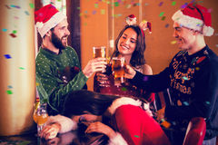 Composite image of festive friends drinking beer and cocktail Royalty Free Stock Images