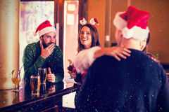 Composite image of festive friends having fun together Stock Photos