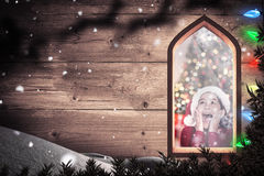 Composite image of festive little girl looking surprised Stock Image