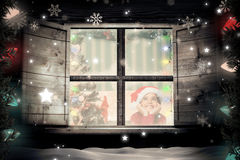 Composite image of festive little girl smiling and looking up Stock Photo