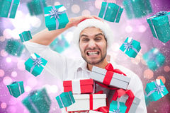 Composite image of festive man holding christmas gifts Royalty Free Stock Photos