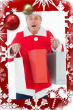 Composite image of festive man holding shopping bags Royalty Free Stock Photo