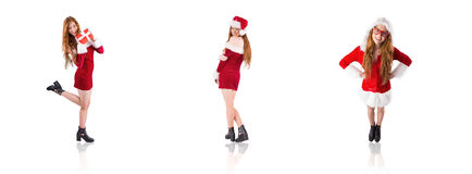 Composite image of festive redhead holding a gift Stock Photography