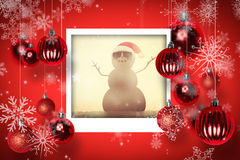 Composite image of festive sandman on the beach Royalty Free Stock Photography