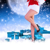 Composite image of festive womans legs in high heels Royalty Free Stock Photo