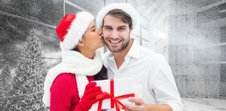 Composite image of festive young couple holding gift Royalty Free Stock Image