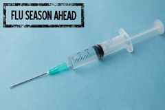 Composite image of fight the flu. With syringe background Stock Images