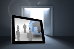 Composite image of figures and earth on tablet screen. Figures and earth on tablet screen against doors opening revealing light Stock Photo