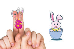 Composite image of fingers as easter bunny. Fingers as easter bunny against easter bunny Royalty Free Stock Photo