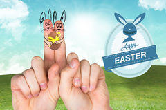 Composite image of fingers as easter bunny Stock Photo