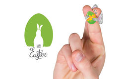 Composite image of fingers as easter bunny. Fingers as easter bunny against happy easter graphic Royalty Free Stock Images