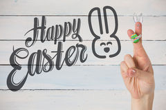 Composite image of fingers as easter bunny. Fingers as easter bunny against painted blue wooden planks royalty free stock images