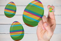 Composite image of fingers as easter bunny. Fingers as easter bunny against painted blue wooden planks stock images