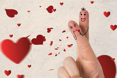 Composite image of fingers crossed like a couple. Fingers crossed like a couple against love heart pattern Royalty Free Stock Images