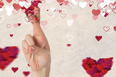 Composite image of fingers crossed like a couple. Fingers crossed like a couple against love heart pattern Stock Photos