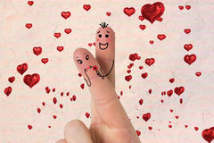Composite image of fingers crossed like a couple. Fingers crossed like a couple against love heart pattern Royalty Free Stock Image