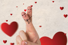 Composite image of fingers crossed like a couple. Fingers crossed like a couple against love heart pattern Stock Image