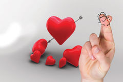 Composite image of fingers crossed like a couple. Fingers crossed like a couple against love hearts Royalty Free Stock Photo