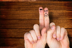 Composite image of fingers crossed like a couple Stock Photo