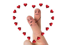 Composite image of fingers crossed like a couple. Fingers crossed like a couple against red love hearts Stock Photography