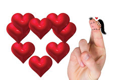 Composite image of fingers crossed like a couple. Fingers crossed like a couple against red love hearts Stock Images