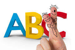 Composite image of fingers posed as students. Fingers posed as students against abc graphic Royalty Free Stock Photos