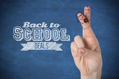 Composite image of fingers posed as students. Fingers posed as students against blue chalkboard Royalty Free Stock Images