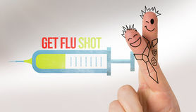 Composite image of fingers posed as students. Fingers posed as students against flu shot message Royalty Free Stock Photography