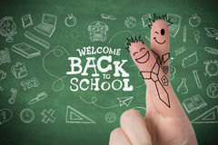 Composite image of fingers posed as students. Fingers posed as students against green chalkboard Royalty Free Stock Image