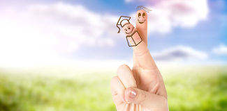 Composite image of fingers posed as students. Fingers posed as students against sunny landscape Royalty Free Stock Image