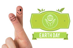 Composite image of fingers smiling. Fingers smiling against earth day graphic Stock Photography