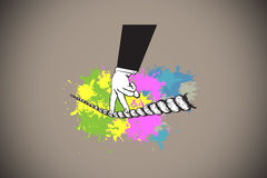 Composite image of fingers walking tightrope on paint splashes Royalty Free Stock Photo