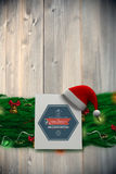 Composite image of fir branch christmas decoration garland Royalty Free Stock Photography