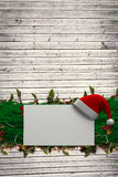 Composite image of fir branch christmas decoration garland Royalty Free Stock Photos