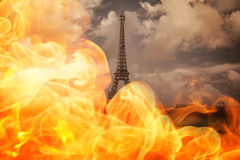 Composite image of fire. Fire against paris under cloudy sky Royalty Free Stock Images