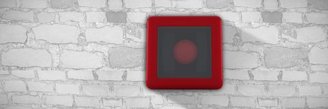Composite image of fire alarm bell. Fire alarm bell against brick wall background Royalty Free Stock Image